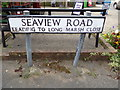 TM5077 : Seaview Road sign by Adrian Cable