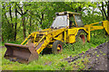 SJ1143 : Old JCB at Carrog by Stephen McKay