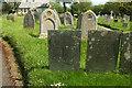 SS5623 : Headstones, churchyard, Yarnscombe by Derek Harper