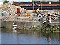 SK5704 : Capping the river bank retaining wall near a swan's nest by Ian Calderwood