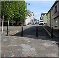 SO2508 : Four black metal posts across Broad Street, Blaenavon by Jaggery