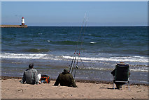 NU0052 : Sea anglers at Sandstell Point by Walter Baxter