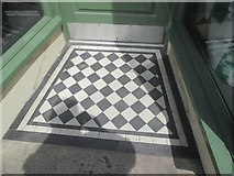 SH6266 : A tiled shop doorway on the High Street, Bethesda by Meirion