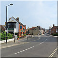 SZ4989 : Newport: Holyrood Street and The Medina Railway Tavern by John Sutton