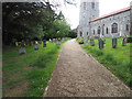 TF8902 : Path to Church entrance through part of graveyard by David Pashley