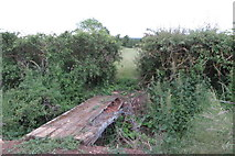 SP9758 : Crumbling footbridge on the path to Rectory Farm by Philip Jeffrey