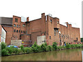 SJ4066 : Brick buildings by the canal by Stephen Craven