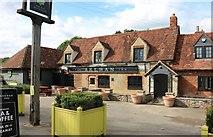 SP6918 : The Akeman Inn, Kingswood by David Howard