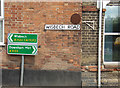 TF5103 : Roadsign & Wisbech Road sign by Adrian Cable