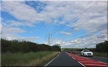 SP6719 : Pylon above Akeman Street, Grendon Underwood by David Howard
