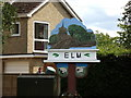 TF4606 : Elm Village sign by Adrian Cable