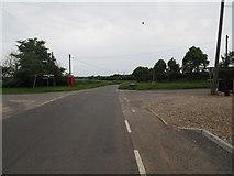 TF8707 : Minor road to Swaffham crossroads by David Pashley