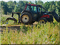 TL9392 : Tractor with attachment for collecting  logs and stacking by David Pashley