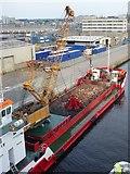 NJ9505 : Unloading rocks by Russel Wills