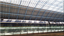 TQ3083 : Roof, train and balcony at St Pancras by David Martin