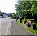 ST3292 : Wooden bench between flower tubs, Caerleon Road, Ponthir by Jaggery
