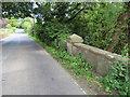 SJ2960 : Rhyd-y-Defaid bridge and milestone on the A5104 by John S Turner