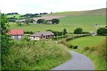 NS9740 : Road down to the railway bridge by Jim Barton