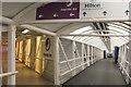 TQ0874 : Covered walkway from Terminal 4 by Derek Harper