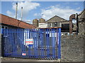 ST6438 : Closed gates of the creamery by Neil Owen