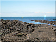 SS7249 : The Lyn River reaches the sea in Lynmouth Bay by John Lucas