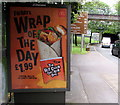 ST3188 : Wrap of the day advert on a Crindau bus shelter, Newport by Jaggery