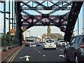 NZ3957 : The A1018 crosses the Wearmouth Bridge by Steve Daniels