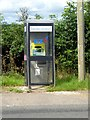 NY6818 : Uses for an old telephone box at Burrells by Oliver Dixon