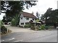 TQ4696 : Log Cabin Café, Abridge by Malc McDonald