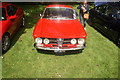 TL7835 : View of an Alfa Romeo Giulia coupe in the Hedingham Castle Classic and Vintage Car Show by Robert Lamb
