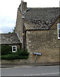ST8080 : Wonky Littleton Drew direction sign in Acton Turville by Peter G.M. Grayson