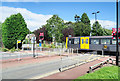 NZ1970 : Metro train at level crossing by Trevor Littlewood