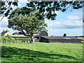 NZ1670 : Barns at Hold House Farm by Trevor Littlewood
