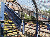 TQ2181 : Footbridge over London Overground railway, Westcott Park by David Hawgood