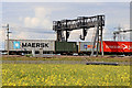 SK1409 : Freight train and gantry near Huddlesford in Staffordshire by Roger  Kidd