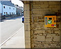SS8974 : Yellow box on a bus shelter wall, Ewenny Road, St Brides Major by Jaggery