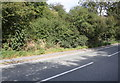 SK8732 : Partly hidden parapet of dismantled mineral railway on NW side of A607 by Luke Shaw
