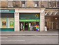 NH6645 : Highland Hospice shop, Queensgate by Craig Wallace