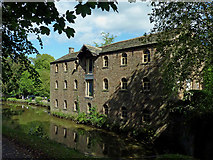 SJ9689 : Converted canalside warehouse by Marple Locks, Stockport by Roger  Kidd