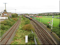 J4792 : Railway lines at Whitehead by Gareth James