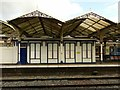 SP8678 : Kettering Station, platform canopies by Alan Murray-Rust