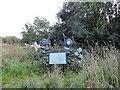 NZ2052 : Signboard and sculpture at Burnside by Robert Graham