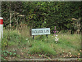 TL9330 : Packards Road sign by Adrian Cable