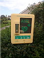 SH6775 : Defibrillator on West Shore, Llanfairfechan by Meirion