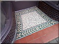 SH6874 : A tiled shop doorway on Station Road, Llanfairfechan by Meirion
