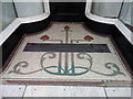 SH6874 : A tiled shop doorway on Village Road, Llanfairfechan by Meirion
