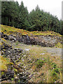 NN1202 : Quarry beside forest road by Trevor Littlewood