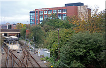 SD8010 : Bury Metrolink Station and Bury College by Chris Allen