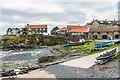 NU2519 : Craster Harbour by Ian Capper