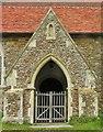 TQ8821 : St Peter & Paul's Church Door in Peasmarsh, East Sussex by John P Reeves